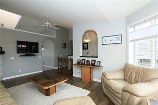 Photo 8: 306 WEST TERRACE Place: Cochrane House for sale : MLS®# C4117766