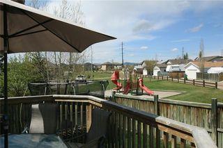 Photo 43: 306 WEST TERRACE Place: Cochrane House for sale : MLS®# C4117766