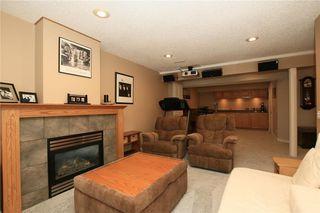 Photo 35: 306 WEST TERRACE Place: Cochrane House for sale : MLS®# C4117766