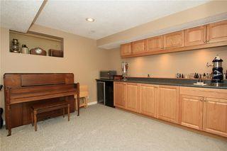 Photo 37: 306 WEST TERRACE Place: Cochrane House for sale : MLS®# C4117766