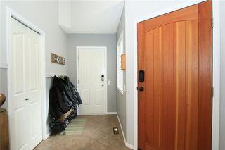 Photo 3: 306 WEST TERRACE Place: Cochrane House for sale : MLS®# C4117766