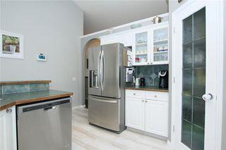 Photo 16: 306 WEST TERRACE Place: Cochrane House for sale : MLS®# C4117766