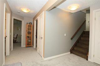 Photo 28: 306 WEST TERRACE Place: Cochrane House for sale : MLS®# C4117766