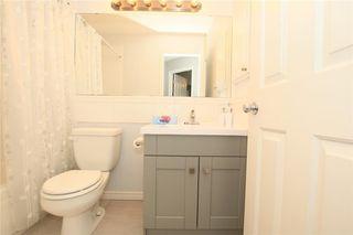 Photo 22: 306 WEST TERRACE Place: Cochrane House for sale : MLS®# C4117766