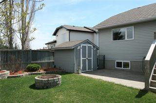 Photo 39: 306 WEST TERRACE Place: Cochrane House for sale : MLS®# C4117766