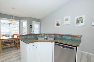 Photo 14: 306 WEST TERRACE Place: Cochrane House for sale : MLS®# C4117766