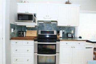 Photo 15: 306 WEST TERRACE Place: Cochrane House for sale : MLS®# C4117766