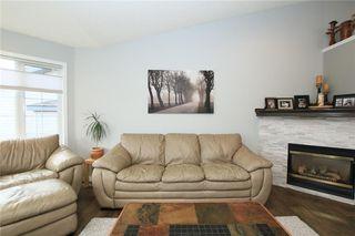 Photo 11: 306 WEST TERRACE Place: Cochrane House for sale : MLS®# C4117766