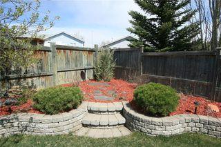 Photo 44: 306 WEST TERRACE Place: Cochrane House for sale : MLS®# C4117766