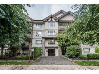"Photo 1: 313 5465 203 Street in Langley: Langley City Condo for sale in ""STATION 54"" : MLS®# R2206615"