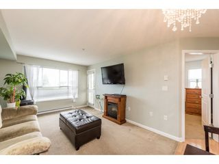 "Photo 4: 313 5465 203 Street in Langley: Langley City Condo for sale in ""STATION 54"" : MLS®# R2206615"