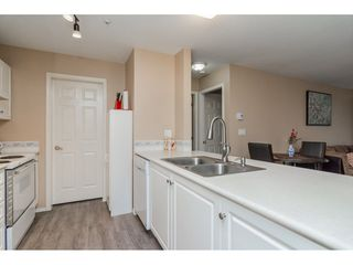 "Photo 11: 206 20277 53 Avenue in Langley: Langley City Condo for sale in ""Metro 11"" : MLS®# R2246436"