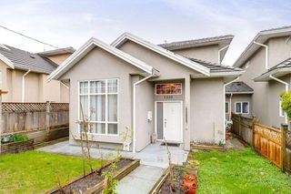 Photo 1: 7330 14TH Avenue in Burnaby: Edmonds BE House 1/2 Duplex for sale (Burnaby East)  : MLS®# R2257150