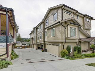 "Photo 1: 4 307 BEGIN Street in Coquitlam: Maillardville Townhouse for sale in ""LAVAL VILLAS"" : MLS®# R2291785"