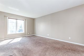 Photo 8: 145 WINDSTONE Avenue SW: Airdrie Row/Townhouse for sale : MLS®# C4260990