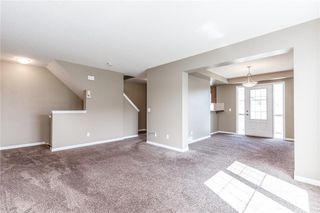 Photo 7: 145 WINDSTONE Avenue SW: Airdrie Row/Townhouse for sale : MLS®# C4260990