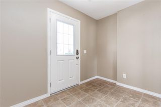 Photo 3: 145 WINDSTONE Avenue SW: Airdrie Row/Townhouse for sale : MLS®# C4260990
