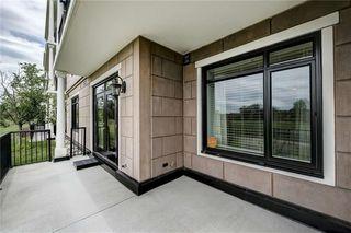 Photo 41: 101 131 QUARRY Way SE in Calgary: Douglasdale/Glen Apartment for sale : MLS®# C4301706