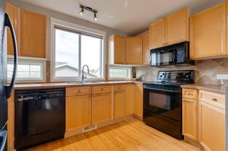 Photo 12: 18 Tuscany Valley Rise NW in Calgary: Tuscany Detached for sale : MLS®# A1034771
