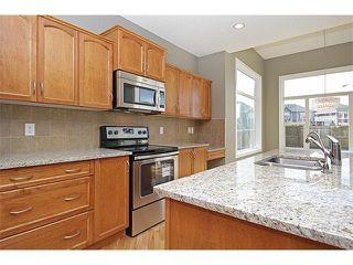 Photo 10: 116 CRANRIDGE Crescent SE in Calgary: Cranston House for sale : MLS®# C4008758