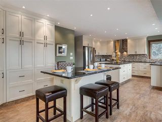 Photo 16: 424 COACH LIGHT Bay SW in Calgary: Coach Hill House for sale : MLS®# C4112862