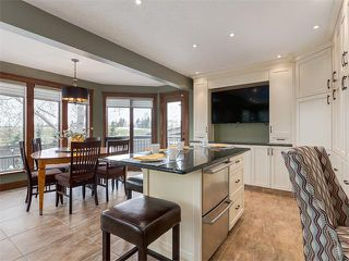 Photo 14: 424 COACH LIGHT Bay SW in Calgary: Coach Hill House for sale : MLS®# C4112862
