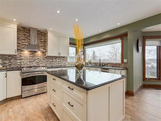 Photo 11: 424 COACH LIGHT Bay SW in Calgary: Coach Hill House for sale : MLS®# C4112862
