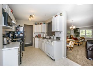 Photo 9: 107 13870 70 Avenue in Surrey: East Newton Condo for sale : MLS®# R2194946