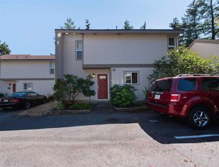 "Photo 1: 6051 W GREENSIDE Drive in Surrey: Cloverdale BC Townhouse for sale in ""Greenside Estates"" (Cloverdale)  : MLS®# R2294928"