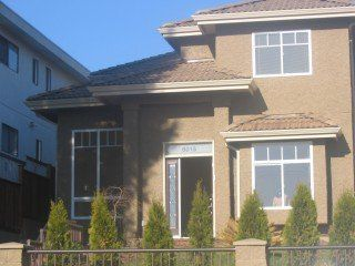 Photo 1: 8015 11TH AV in Burnaby: Home for sale : MLS®# V501503