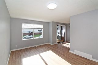 Photo 5: 128 FALCONRIDGE Crescent NE in Calgary: Falconridge Semi Detached for sale : MLS®# C4302910