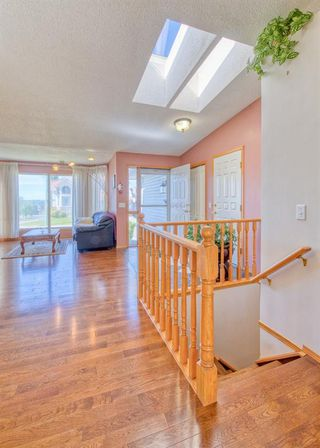 Photo 7: 404 HAWKSIDE Mews NW in Calgary: Hawkwood Detached for sale : MLS®# A1014613