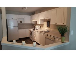 """Photo 1: 204 5499 203RD Street in Langley: Langley City Condo for sale in """"PIONEER PLACE"""" : MLS®# F1448758"""