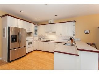 "Photo 9: 73 5811 122 Street in Surrey: Panorama Ridge Townhouse for sale in ""Lakebridge"" : MLS®# R2045411"