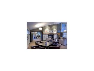 """Photo 13: 409 300 KLAHANIE Drive in Port Moody: Port Moody Centre Condo for sale in """"TIDES"""" : MLS®# R2213447"""