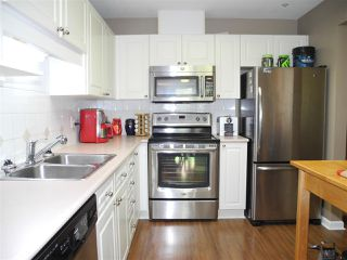 """Photo 2: 206 19131 FORD Road in Pitt Meadows: Central Meadows Condo for sale in """"WOODFORD MANOR"""" : MLS®# R2296738"""
