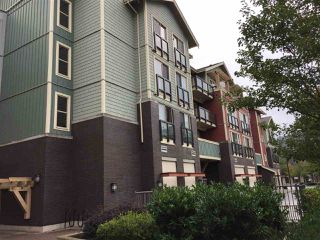 "Photo 1: 206 45530 MARKET Way in Sardis: Vedder S Watson-Promontory Condo for sale in ""The Residences"" : MLS®# R2309179"