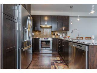"Photo 4: 301 6480 194 Street in Surrey: Clayton Condo for sale in ""Watersone"" (Cloverdale)  : MLS®# R2358792"