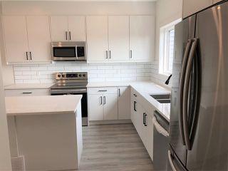 Photo 3: 303 Orchards Boulevard in Edmonton: Zone 53 House Half Duplex for sale : MLS®# E4172082