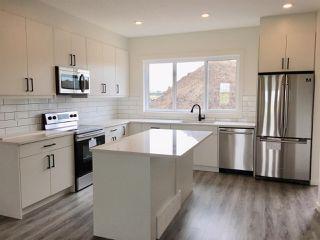 Photo 2: 303 Orchards Boulevard in Edmonton: Zone 53 House Half Duplex for sale : MLS®# E4172082