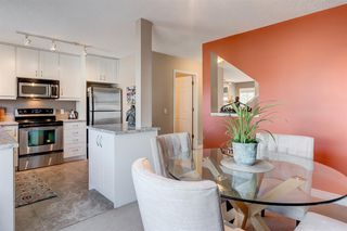 Photo 9: 1203 7171 COACH HILL Road SW in Calgary: Coach Hill Row/Townhouse for sale : MLS®# A1030861