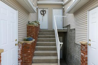 Photo 2: 1203 7171 COACH HILL Road SW in Calgary: Coach Hill Row/Townhouse for sale : MLS®# A1030861
