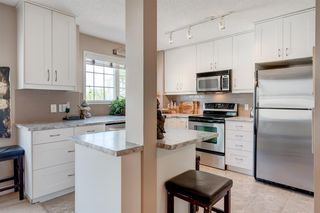 Photo 4: 1203 7171 COACH HILL Road SW in Calgary: Coach Hill Row/Townhouse for sale : MLS®# A1030861
