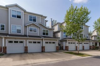Photo 1: 1203 7171 COACH HILL Road SW in Calgary: Coach Hill Row/Townhouse for sale : MLS®# A1030861
