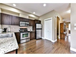 "Photo 8: 30 7088 191ST Street in Surrey: Clayton Townhouse for sale in ""MONTANA"" (Cloverdale)  : MLS®# F1441520"