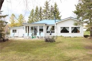 Photo 1: 243 Mcguires Beach Road in Kawartha Lakes: Rural Carden House (Bungalow) for sale : MLS®# X3453643