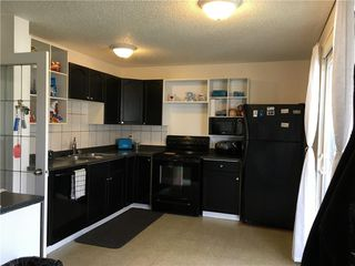 Photo 5: 43 ERIN WOODS Drive SE in Calgary: Erin Woods House for sale : MLS®# C4125302
