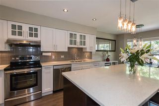 """Photo 1: 41 650 ROCHE POINT Drive in North Vancouver: Roche Point Townhouse for sale in """"Raven Woods"""" : MLS®# R2188844"""