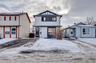 Photo 1: 111 ERIN RIDGE Road SE in Calgary: Erin Woods House for sale : MLS®# C4162823