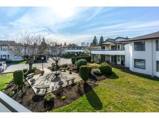 "Photo 1: 220 15153 98 Avenue in Surrey: Guildford Townhouse for sale in ""Glenwood Villiage"" (North Surrey)  : MLS®# R2246707"